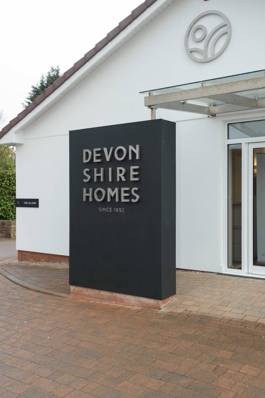 main entrance totem sign with raised stainless lettering